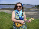 Anna Lyman at the Nanaimo seawall with her pineapple flea, ukulele